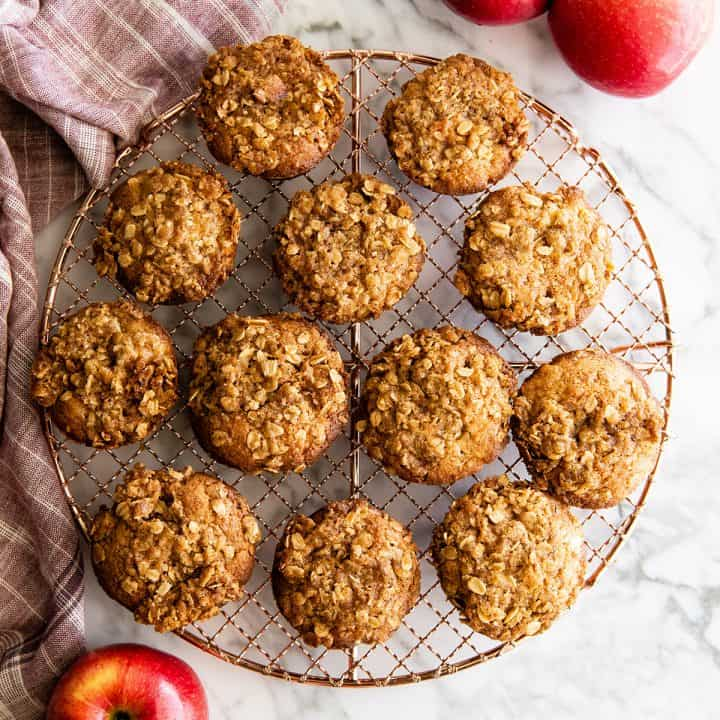 Overhead photo of apple muffins on a wire cooling rack