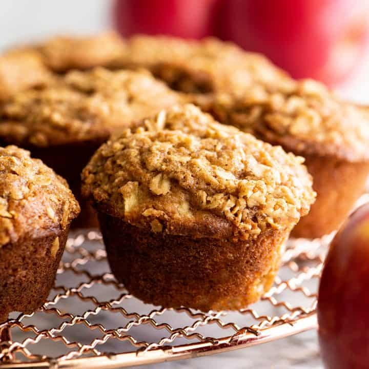 cinnamon apple muffins on a wire cooling rack