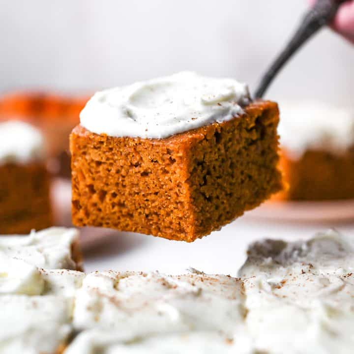 front photo of a piece of Pumpkin Cake being lifted out of the baking pan