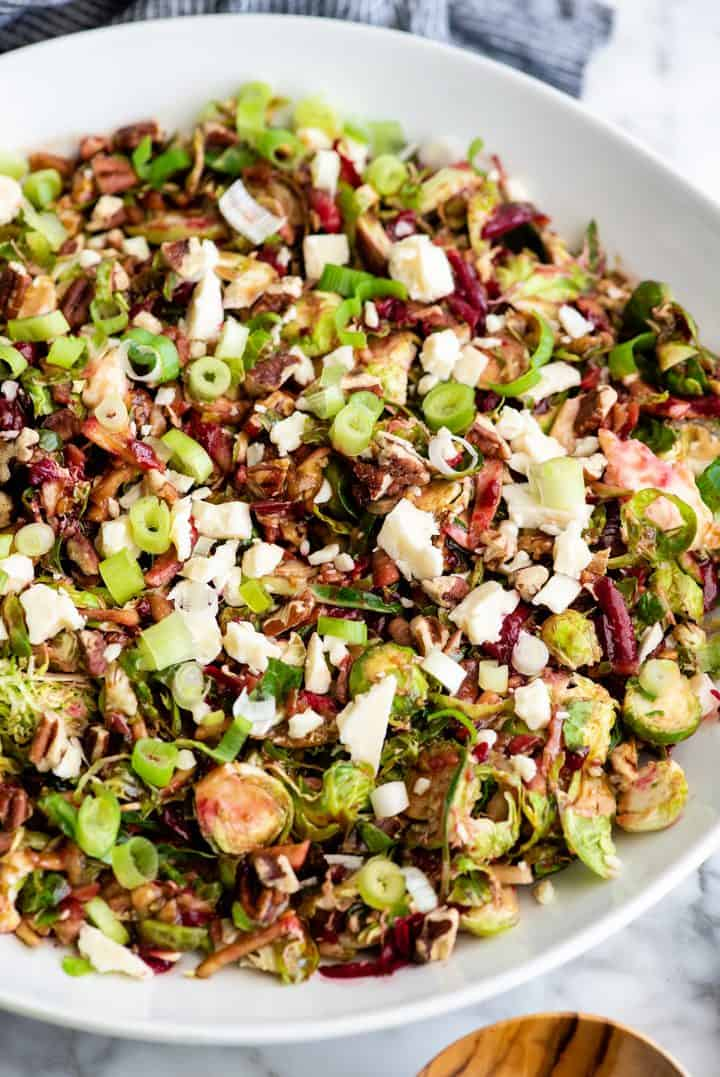 overhead view of Brussel Sprouts Salad in a large white serving bowl
