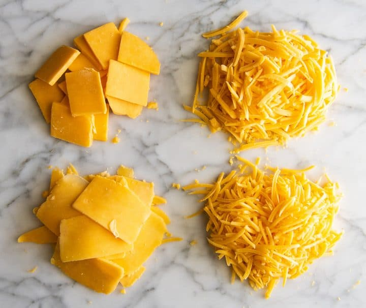 overhead view of cheese sliced and shredded 4 ways with the Vitamix food processor