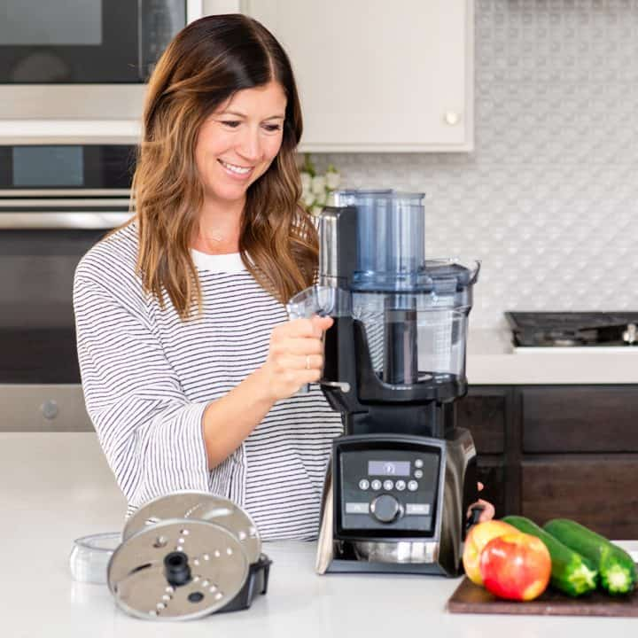 Woman holding vitamix food processor attachment