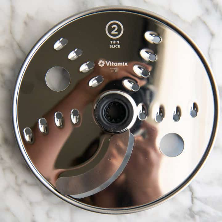 overhead photo of the thin slice disc for the Vitamix food processor