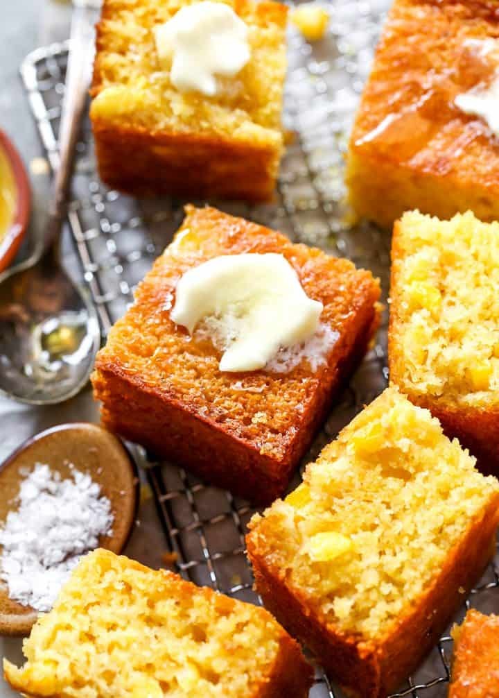 front view of slices of cornbread with butter