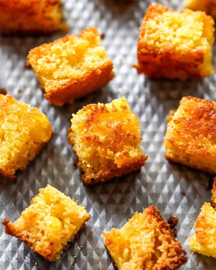 up-close overhead view of Cornbread Croutons on a baking sheet