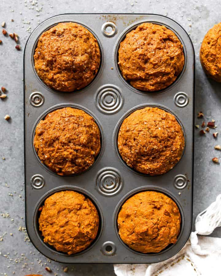 overhead photo of 6 Healthy Pumpkin Muffins in a muffin tin