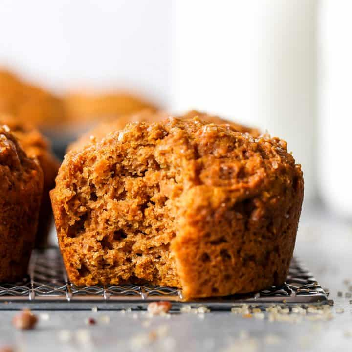 front view of a Healthy Pumpkin Muffin with a bite taken out of it
