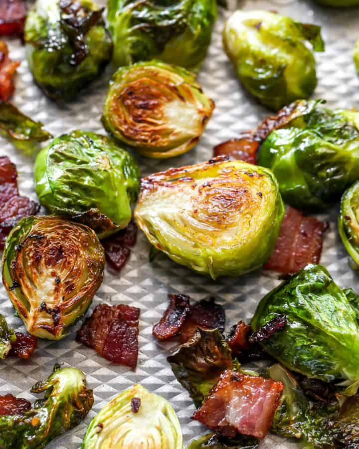 up close view of Brussel Sprouts with Bacon on a baking sheet