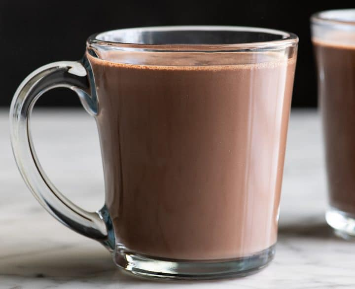 front view of a glass mug of homemade hot cocoa