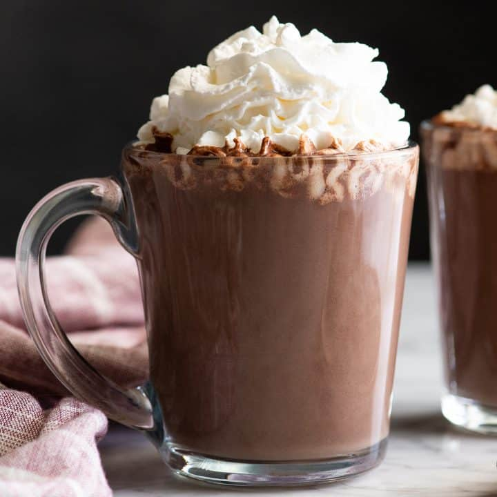 front view of a mug of homemade hot chocolate with whipped cream