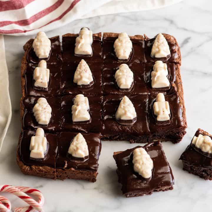 16 Peppermint Brownies with peppermint bark candies on top