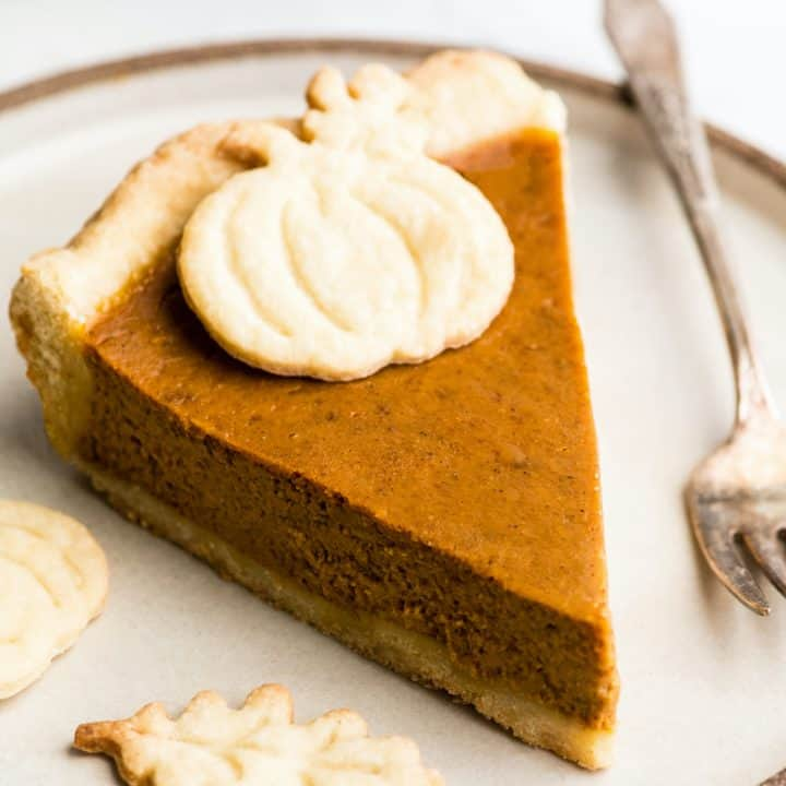 pumpkin pie on a plate in a roundup of Best Thanksgiving Recipes