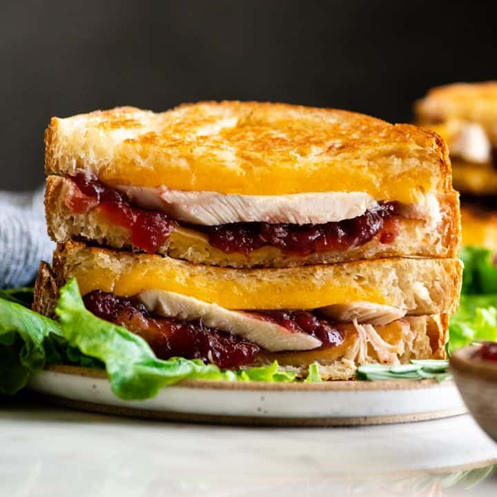 front view of two halves of a turkey cranberry sandwich stacked on each other