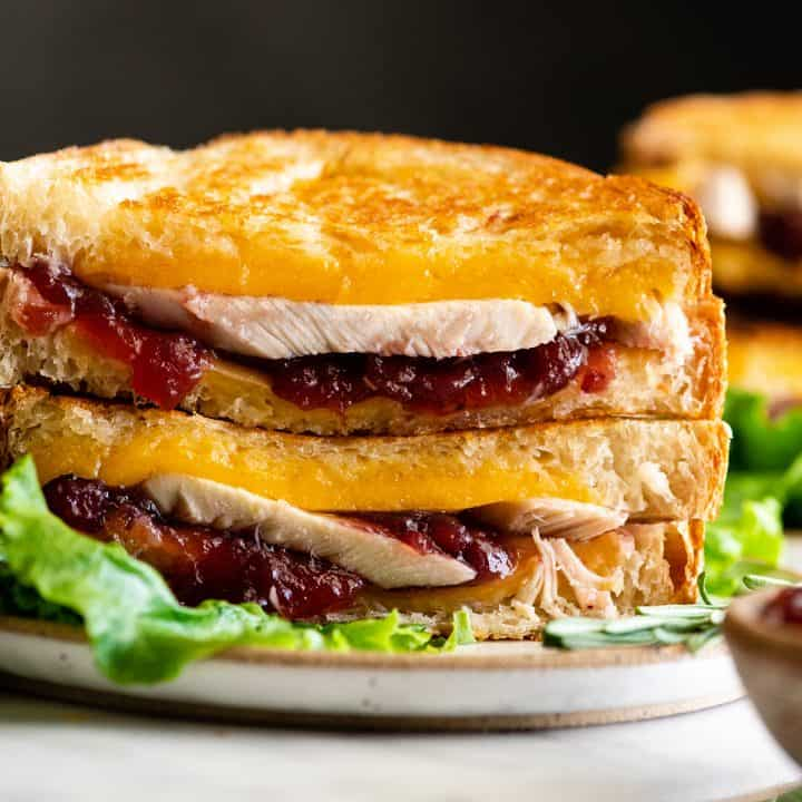 up close front photo of two halves of a Turkey Cranberry Sandwich stacked on each other