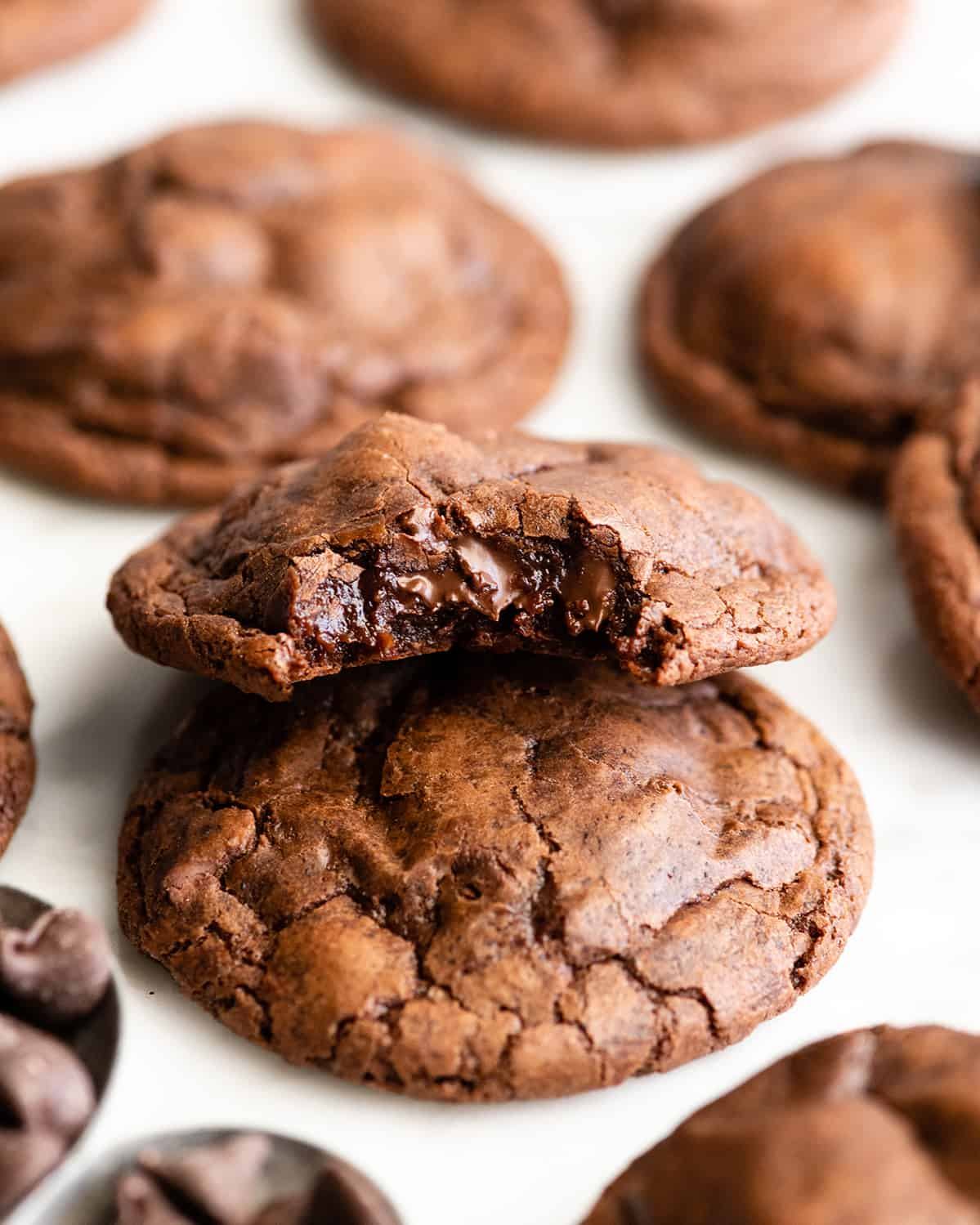 front view of Chocolate Brownie Cookies, one with a bite taken out of it