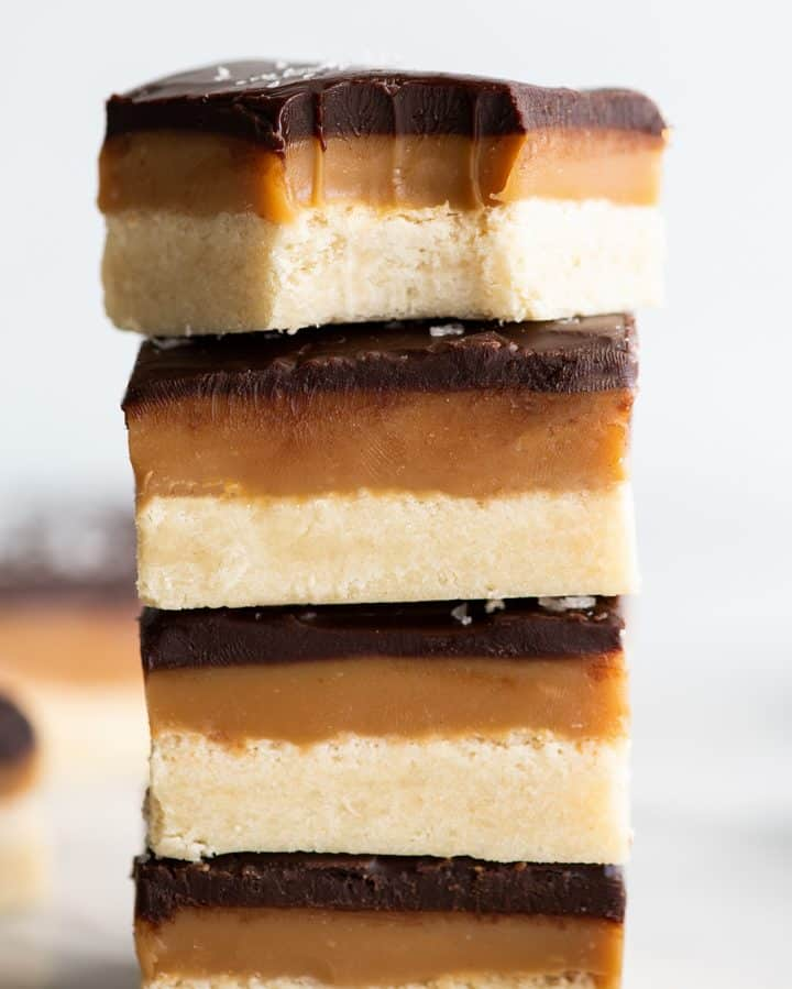 stack of 4 millionaire shortbread bars, the top has a bite taken out of it