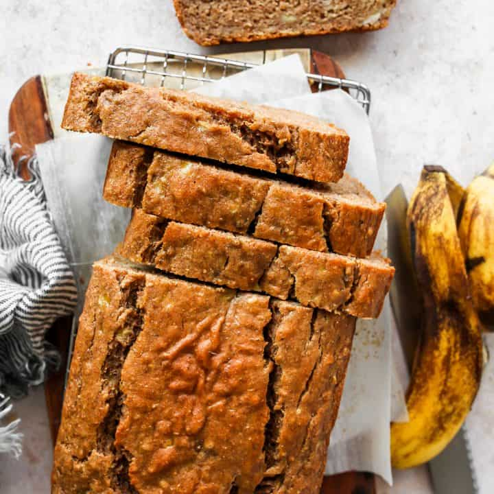 overhead view of a loaf of Healthy Banana Bread with 3 slices cut out