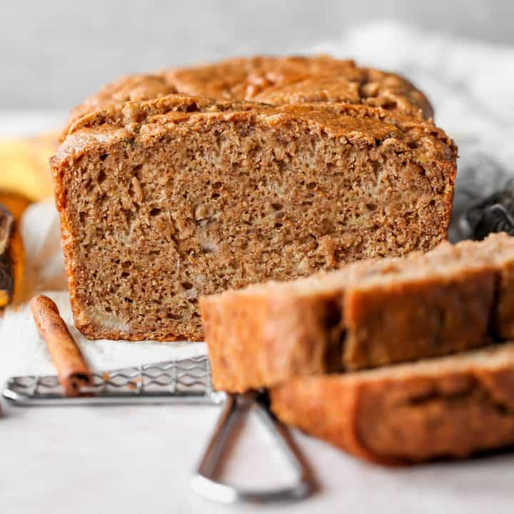 front view of a loaf of Healthy Banana Bread with two slices cut out of it