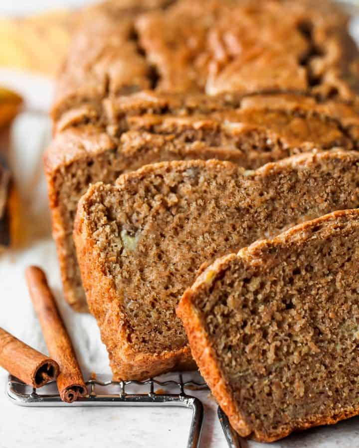 front view of a loaf of healthy banana bread with 4 slices cut