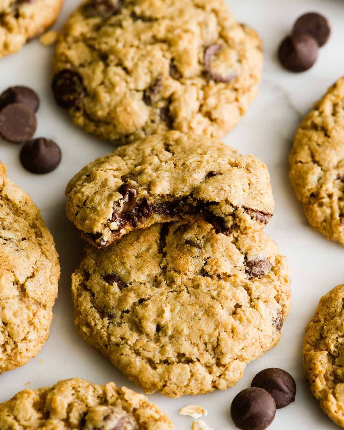 overhead photo fo 3 lactation cookies, one with a bite taken out of it