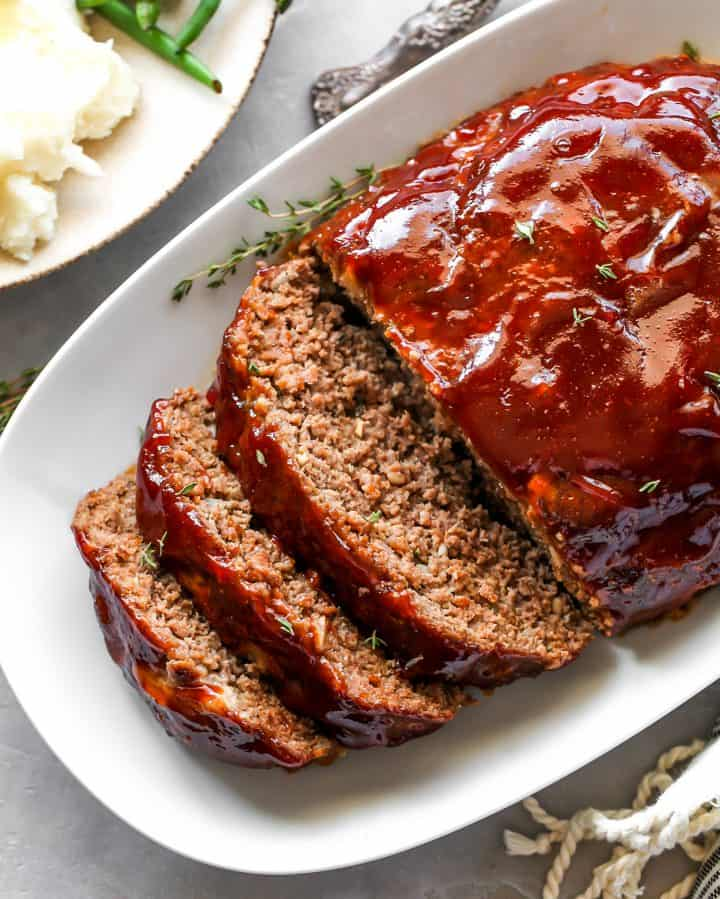 overhead view of the best meatloaf cut into slices on a serving platter
