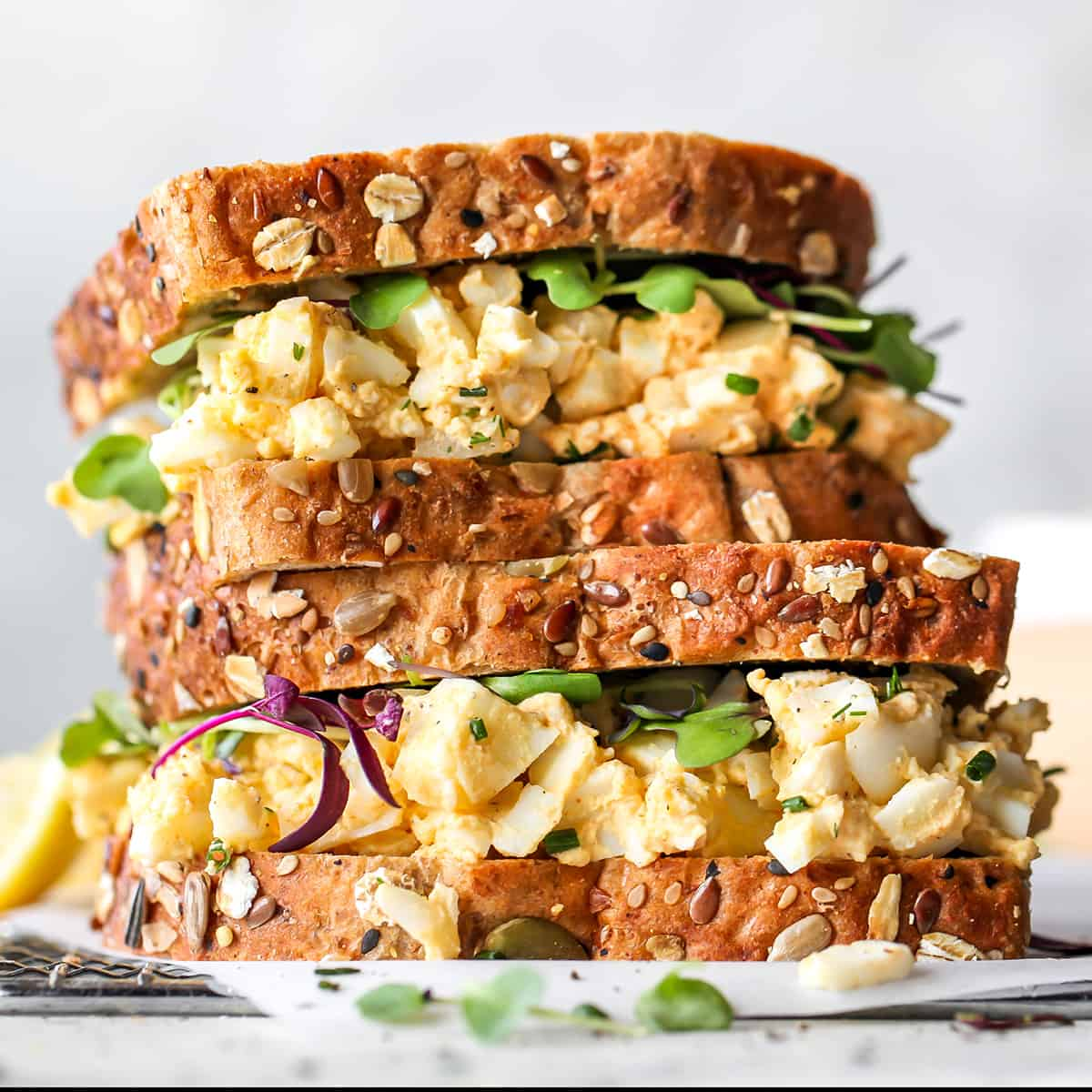 photo of two egg salad sandwiches stacked on each other