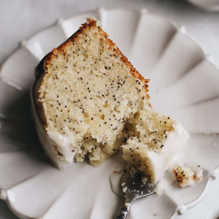 overhead view of a slice of Poppy Seed Cake with a fork taking a bite