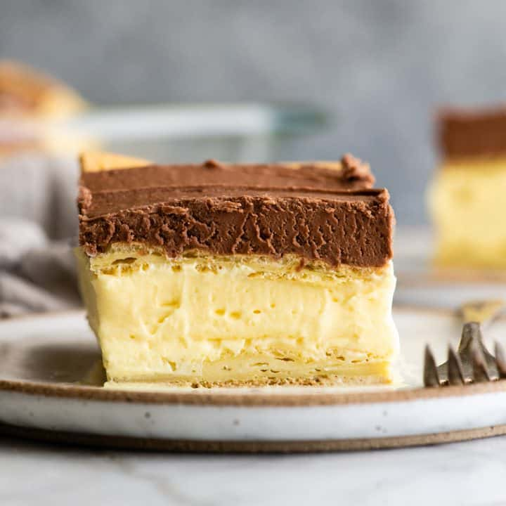 piece of Chocolate Eclair Cake on a plate