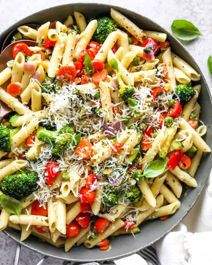 Pasta Primavera Recipe in a pan topped with parmesan cheese