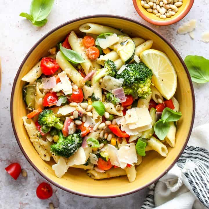 a bowl of Pasta Primavera topped with pine nuts