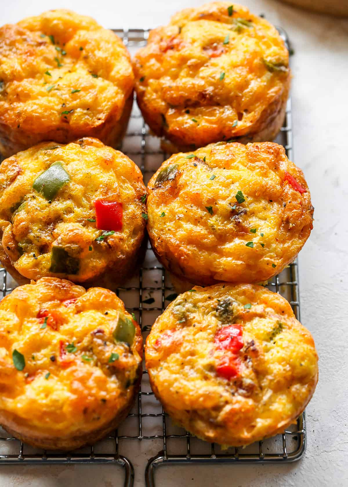 overhead view of 6 Breakfast Egg Muffins (Egg Cups) on a cooling rack