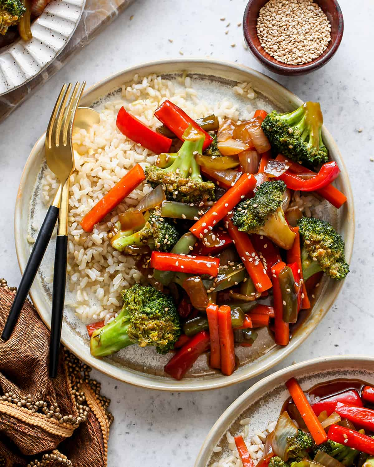 overhead view of a plate of stir fry vegetables with rice