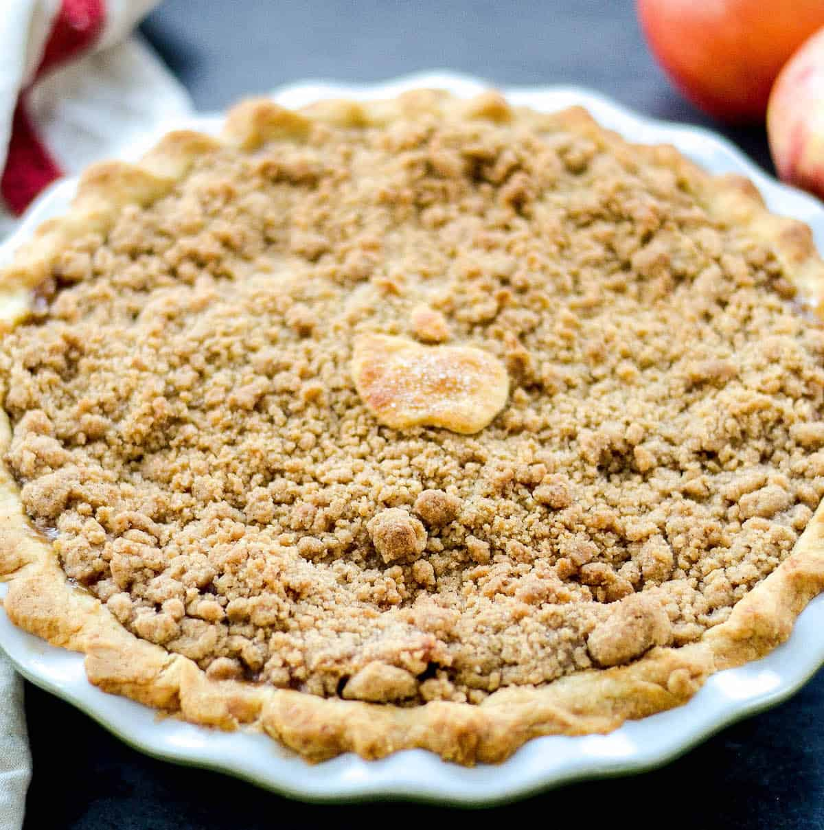 Front view of homemade apple crumble pie.