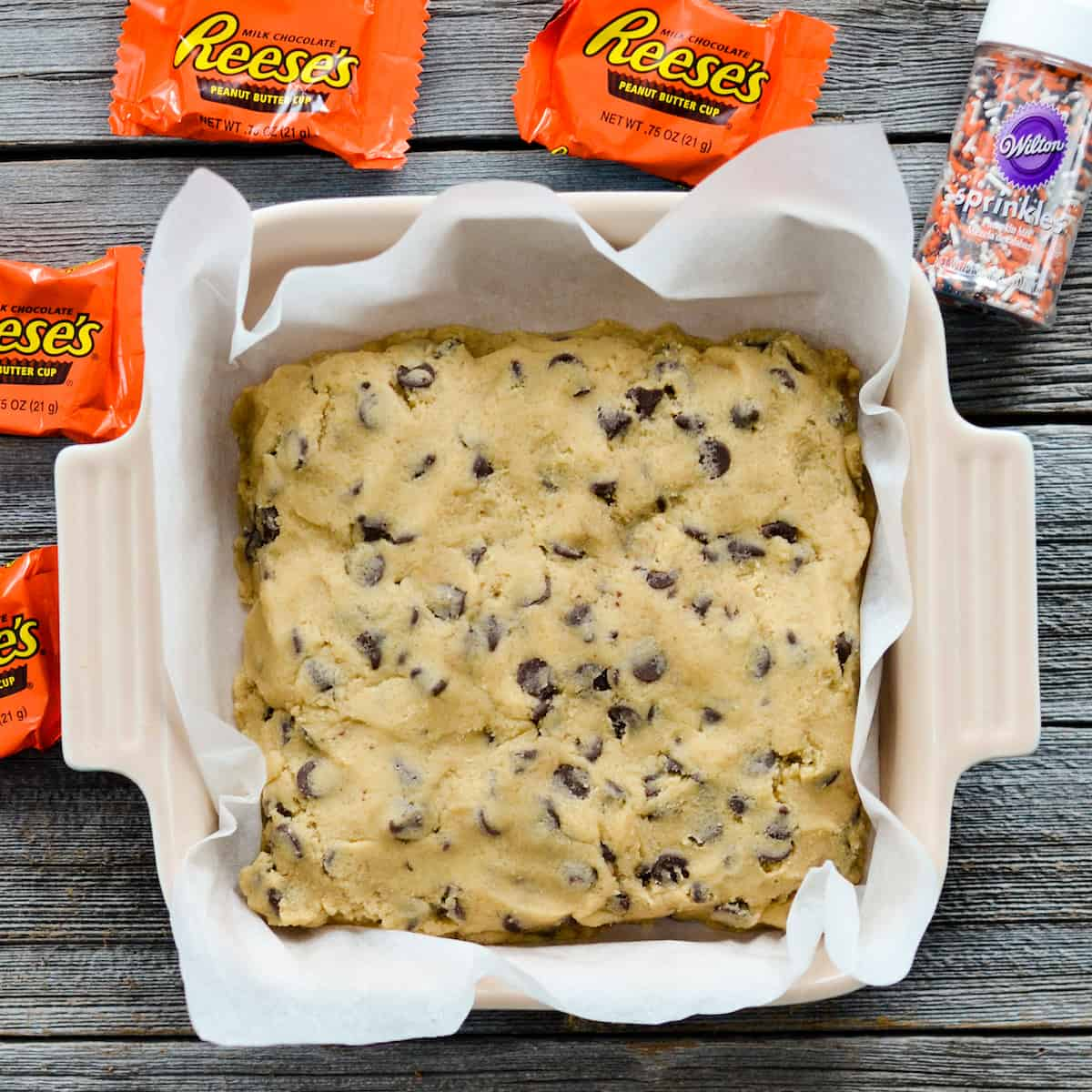 Overhead view of Candy Cookie Bars in a baking dish before baking .
