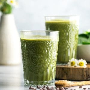 front view of two glasses of chocolate peanut butter green smoothie