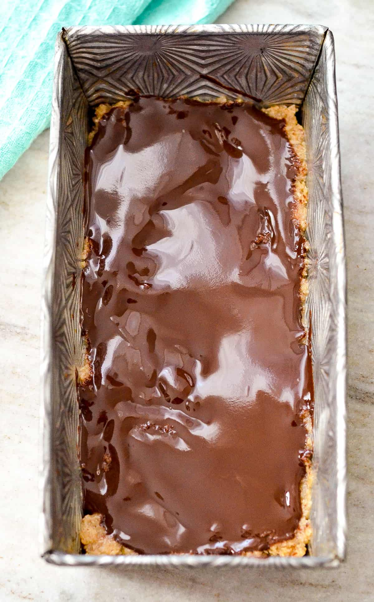 Overview photo of no bake bars with chocolate layer on top.