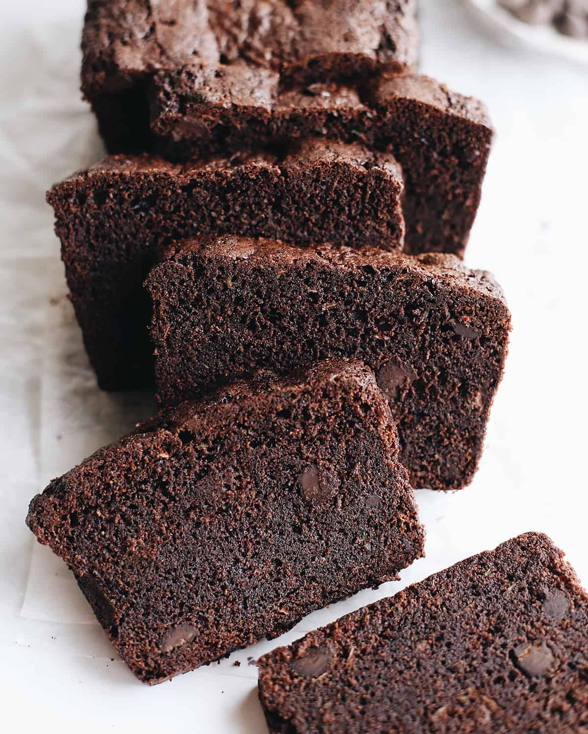 overhead photo of Double Chocolate Zucchini Bread with 5 slices cut out of it