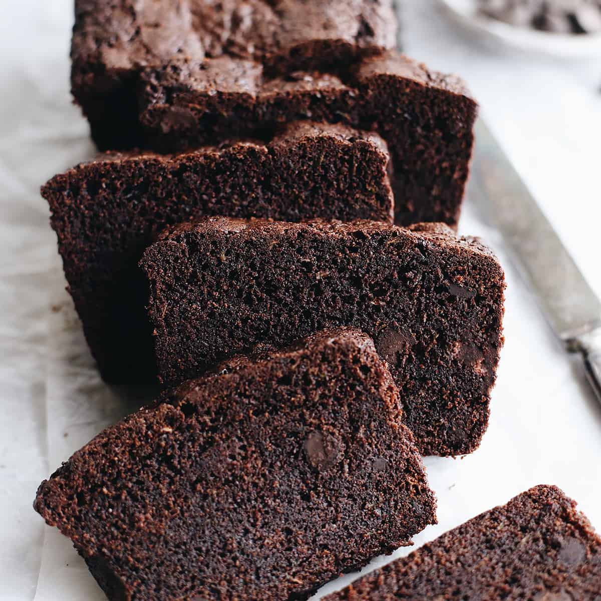 front view of 4 slices of chocolate zucchini bread