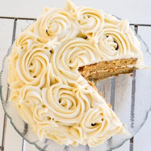 Overhead view of a Gluten-Free Carrot Cake with a piece cut out of it
