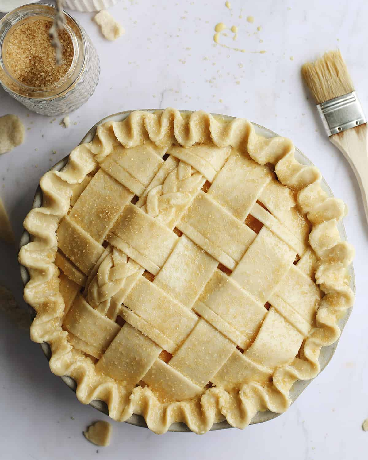 Peach Pie with a lattice crust before being baked