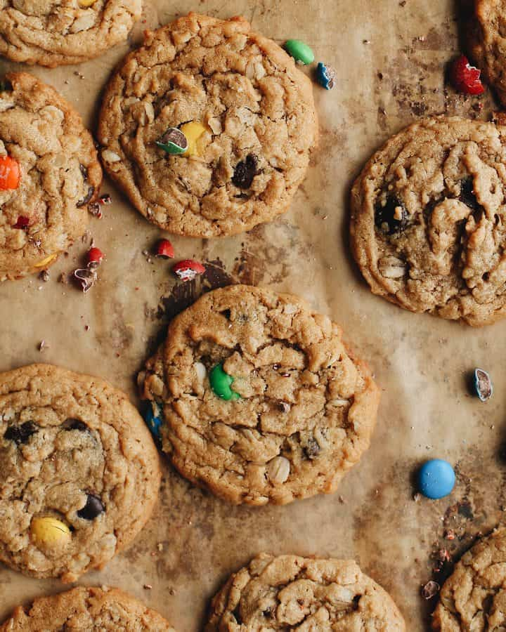 overhead view of 6 Monster Cookies on parchment paper