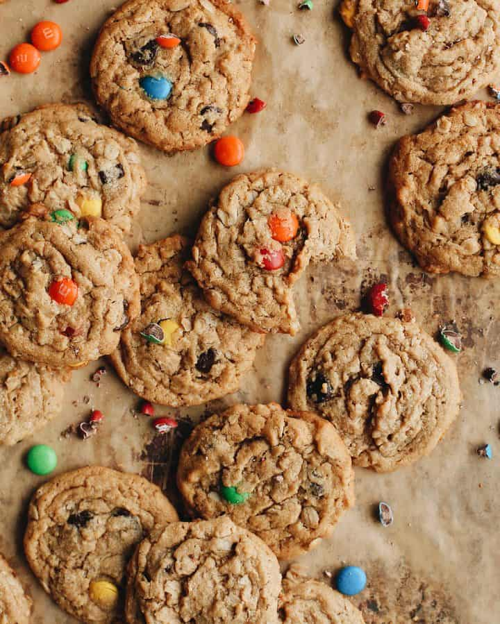 overhead view of 11 Monster Cookies, one with a bite taken out of it
