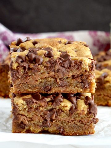 Front view of two vegan paleo blondies stacked on top of each other.