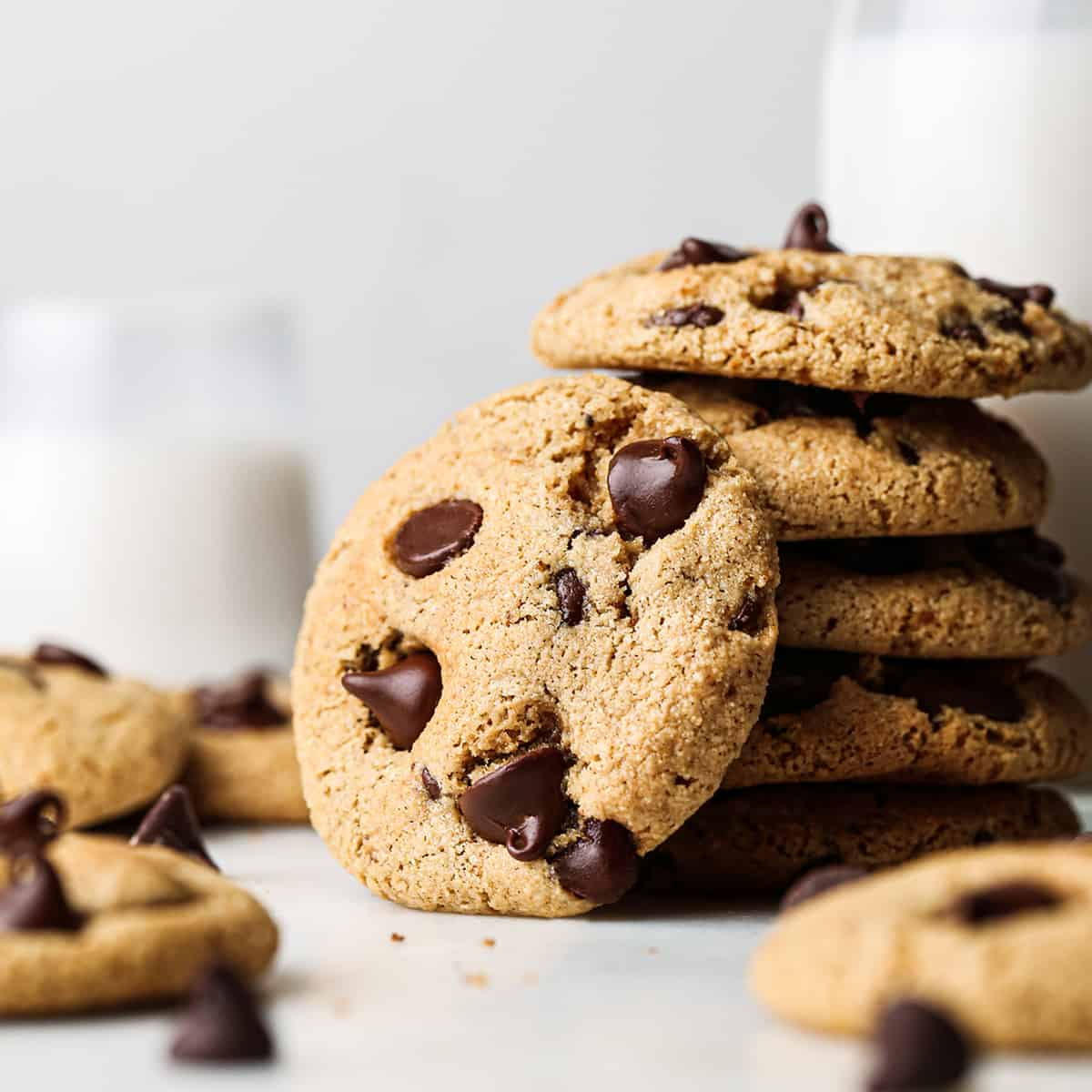 stack of 5 Paleo Chocolate Chip Cookies with one cookie leaning on it