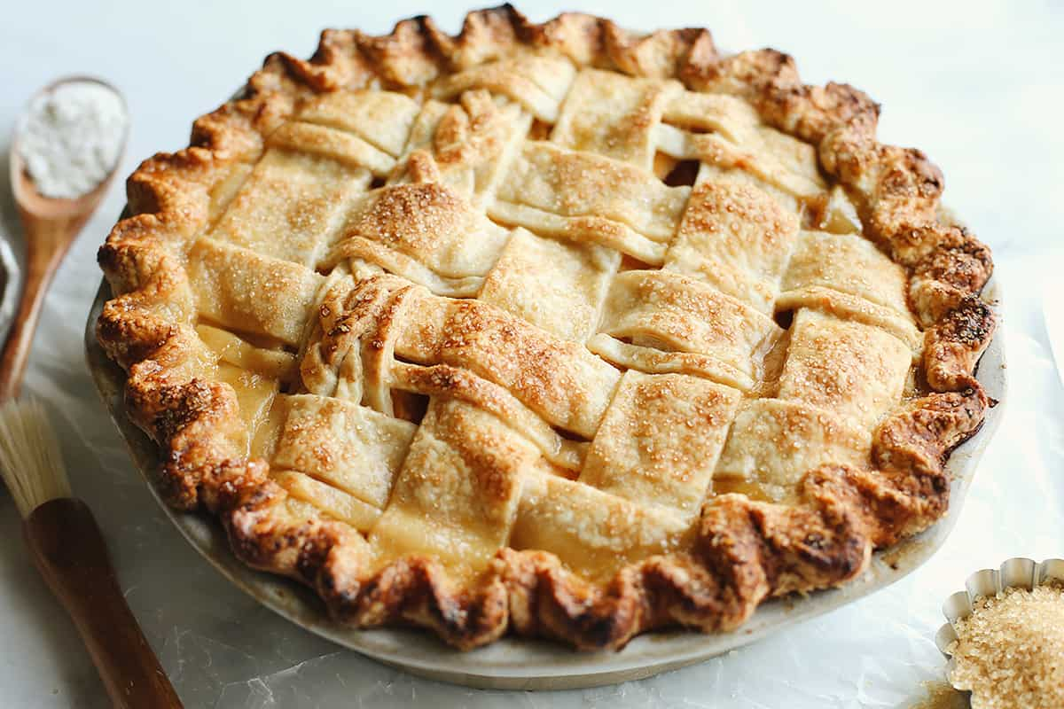 Peach pie with a lattice crust after being baked in a pie dish