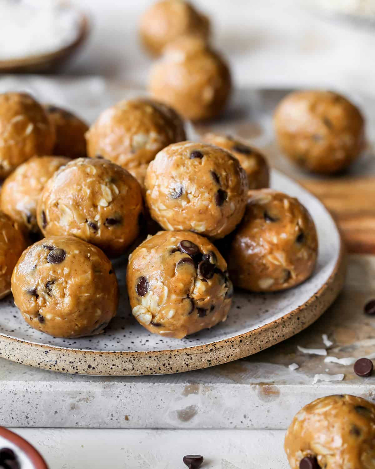 10 Peanut Butter Protein Balls (Energy Balls) stacked on a plate