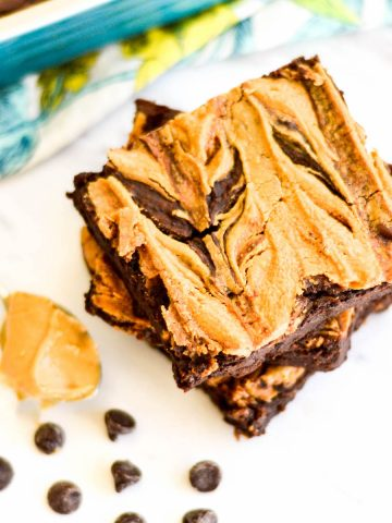Overhead view of a stack of Vegan Black Bean Brownies with Peanut Butter with a peanut butter swirl on top.