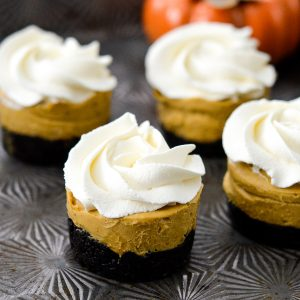 Front view of a No-Bake Vegan Pumpkin Pies with four others int he background.