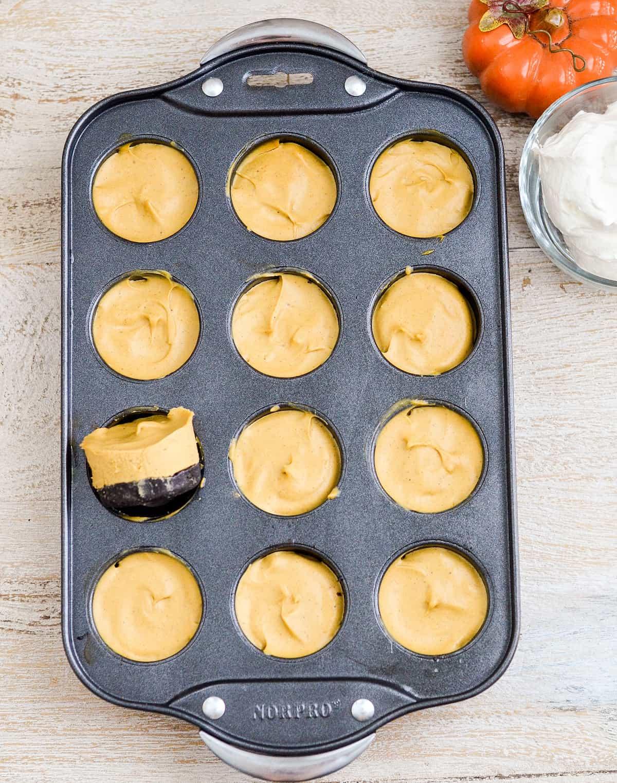 Overhead view of No-Bake Vegan Pumpkin Pies in a mini cheesecake pan.