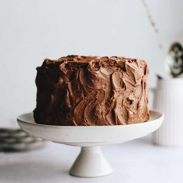 photo of a Yellow Cake frosting with chocolate frosting on a cake plate